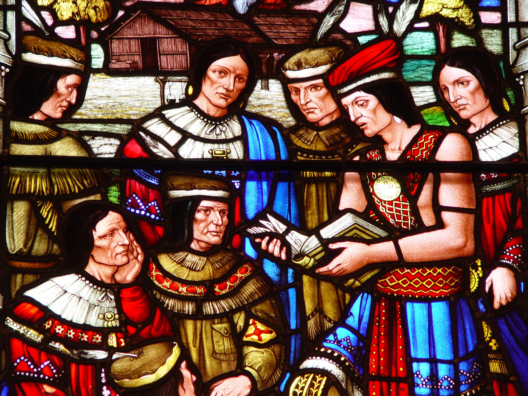Stain glass depicting the Mohawk people reading the Gospel in community