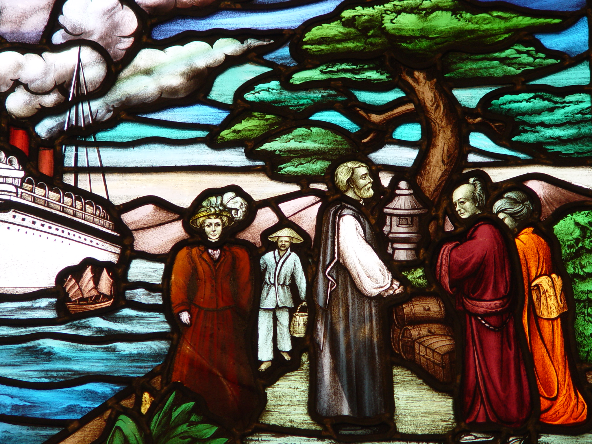 Stain glass depicting The Rev. and Mrs. James Cooper Robinson arrived in Japan on September 15, 1889