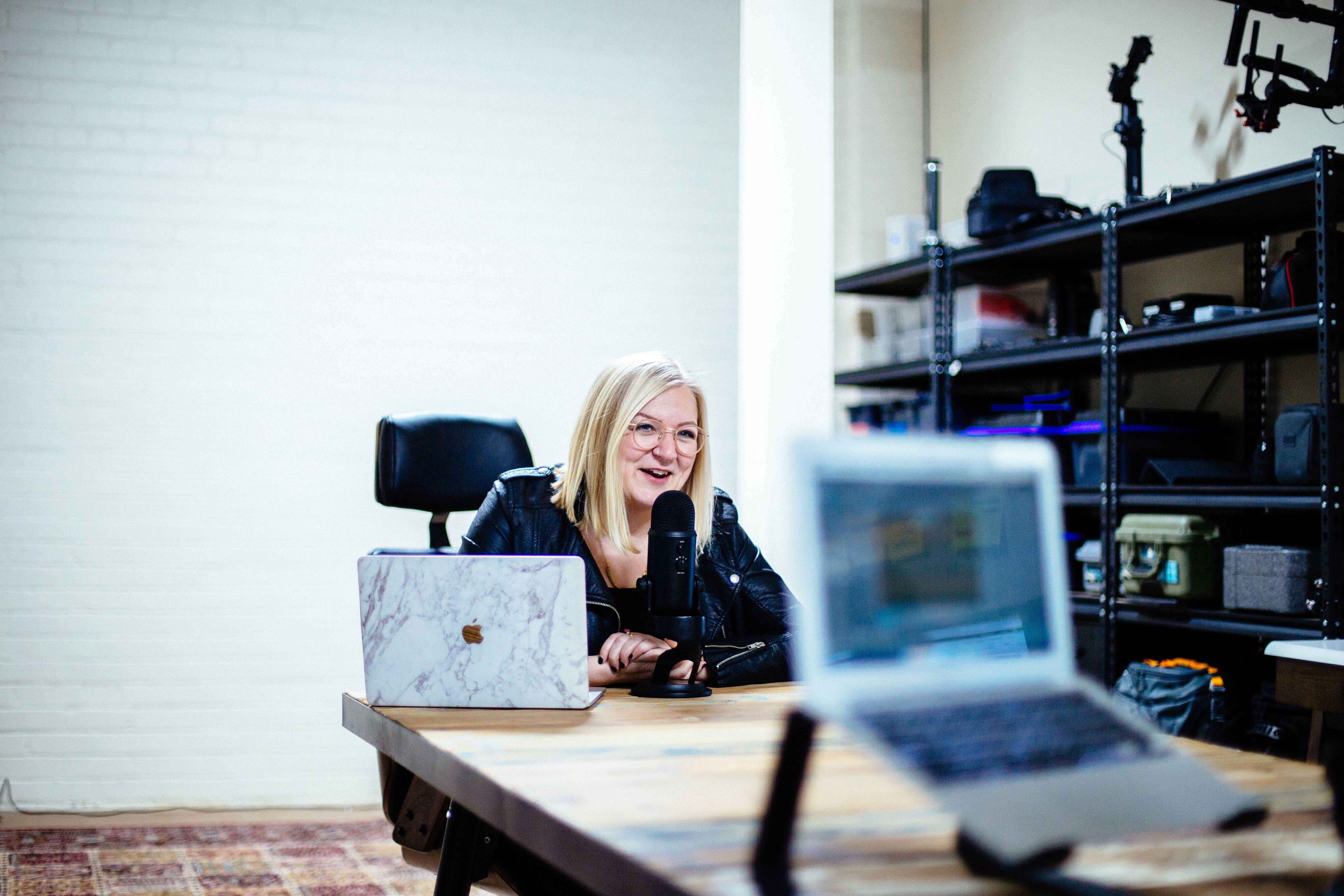 Joanna la Fleur recording a podcast in her studio