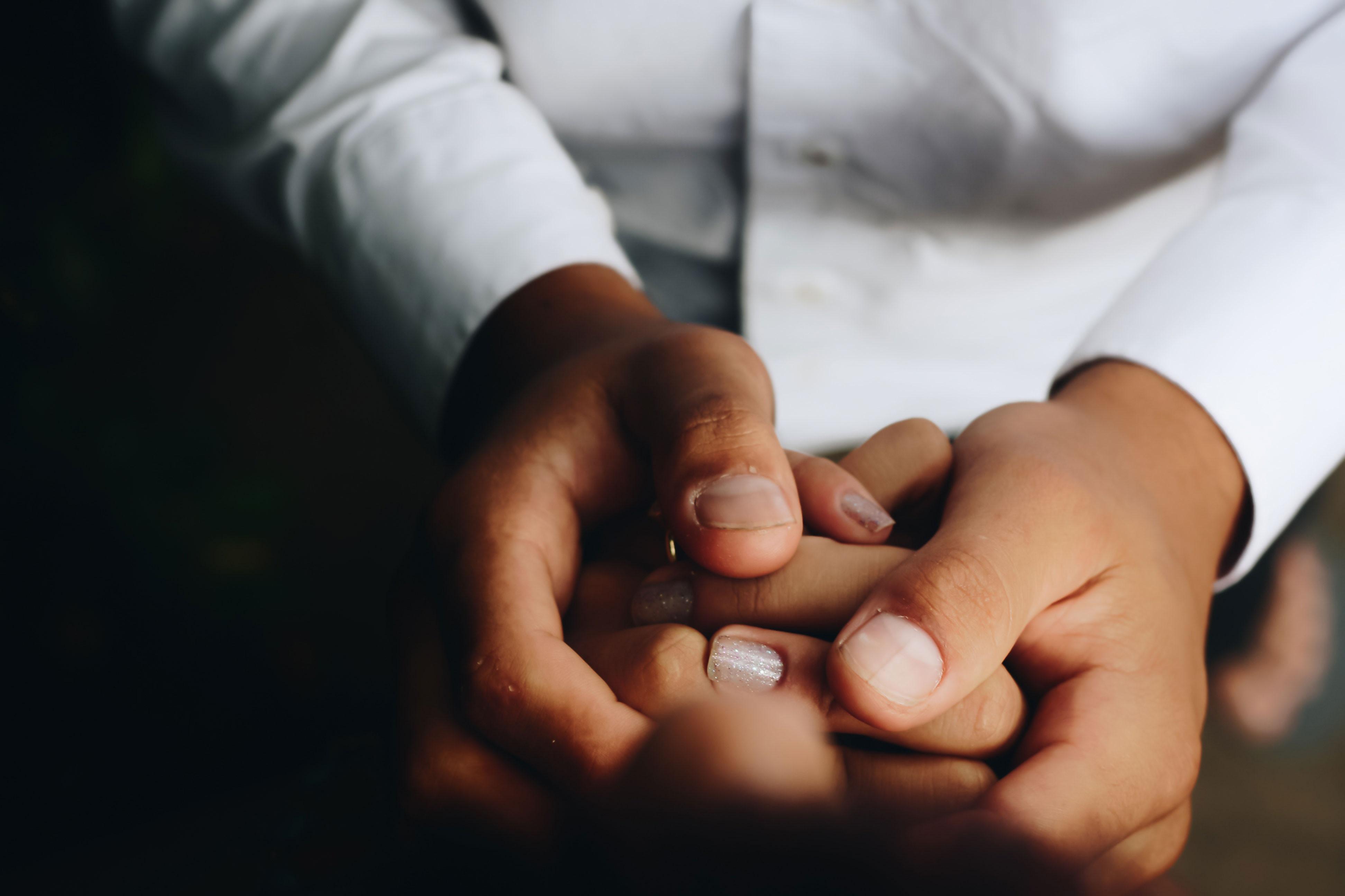 Holding hands - Photo by Matheus Ferrero on Unsplash