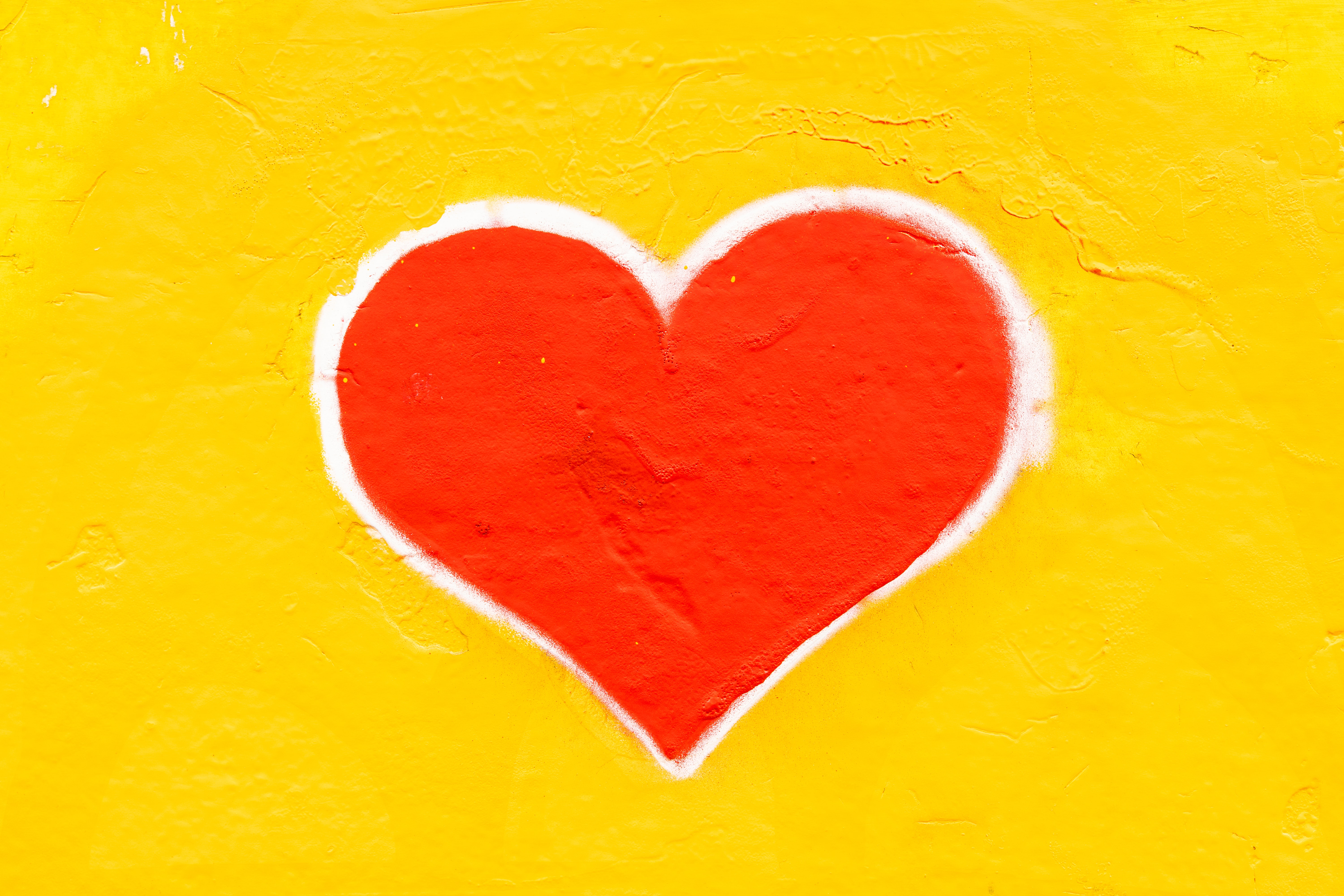 Red heart on yellow background