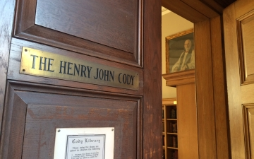 Dyson Hague's portrait is seen through the door of the Cody Library