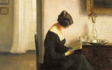19th-century woman reading in an interior oil painting