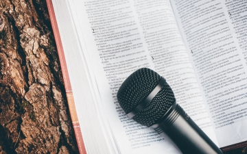 Microphone on open Bible by Arthur Miranda Unsplash