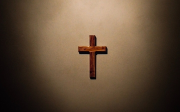 wooden cross on a blank wall