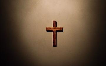 wooden cross on a blank wall