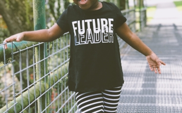 Little girl wearing future leader t-shirt
