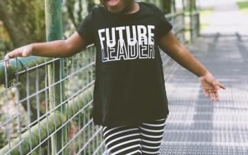 Little girl wearing future leader t-shirt