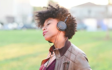 Woman listening to music with eyes closed
