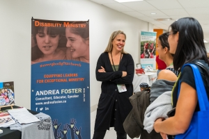 Andrea Foster talking with participants at the Disability ministry booth