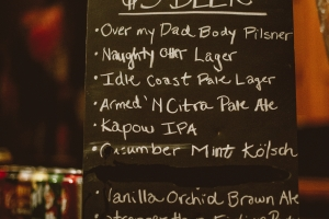 A chalk board sign showing the list of beer selections