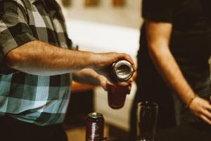Steve Hewko pouring beer